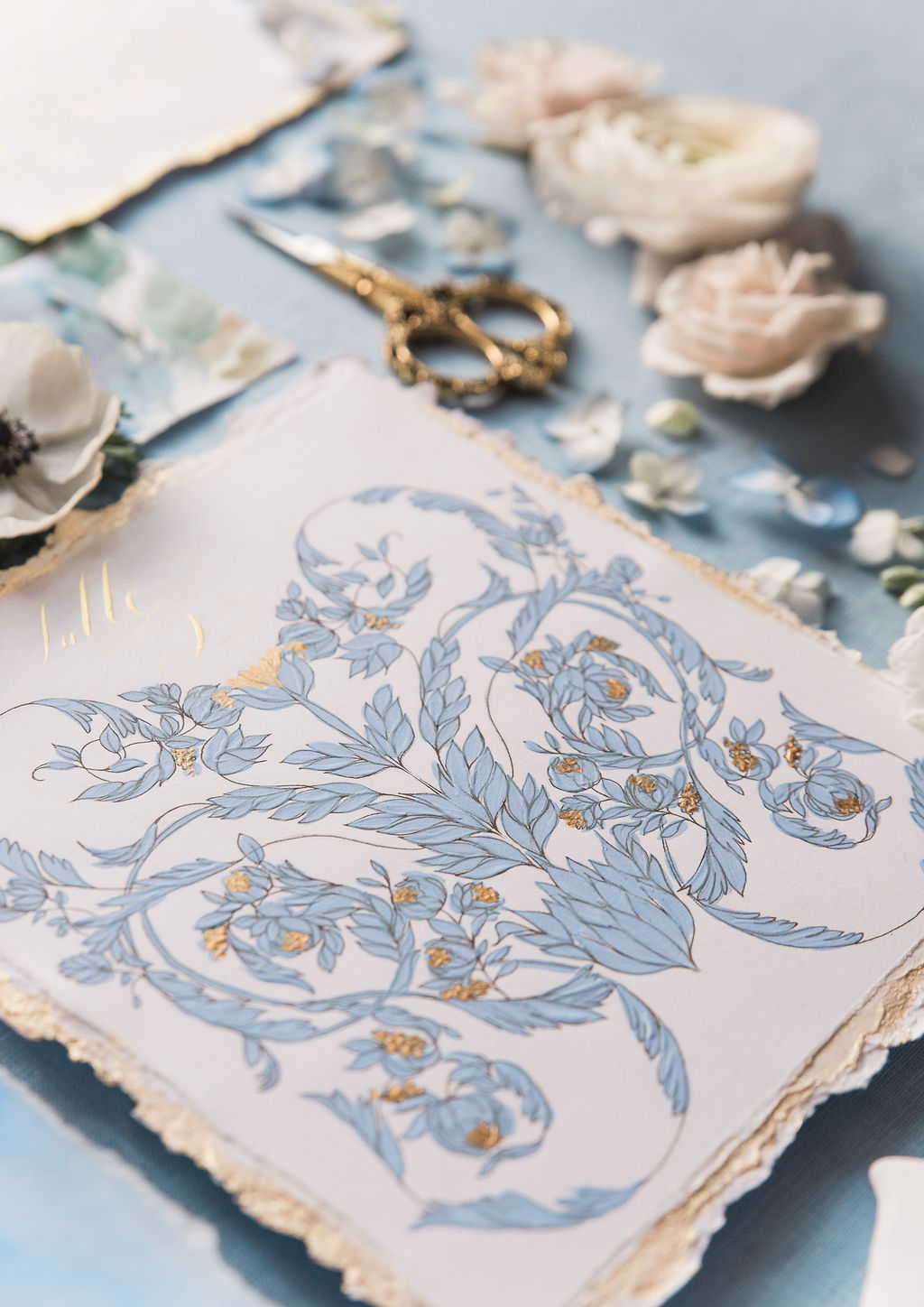 Blue and gold hand painted wedding stationery for a French destinationwedding. This image features a table number with creative floral designs, perfect for a high end wedding in Paris.