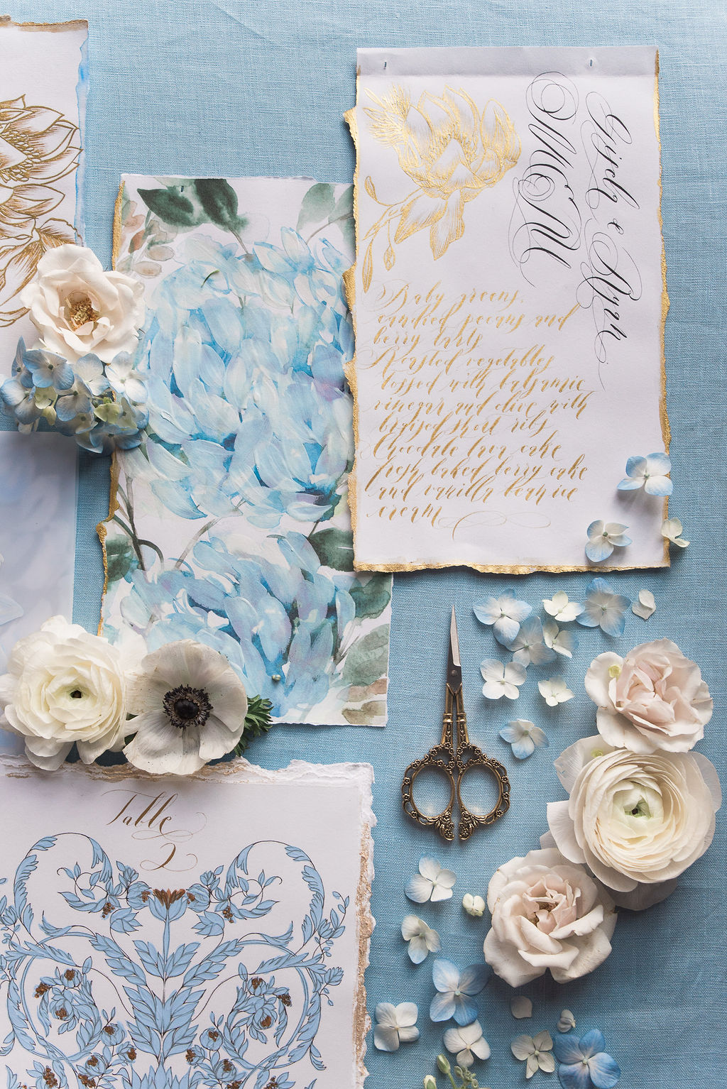 Blue and gold wedding menu with hand torn edges