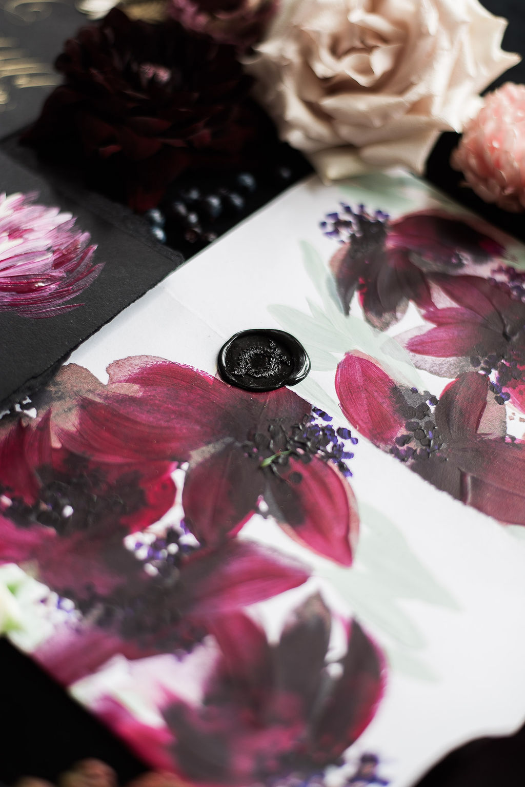 Dark magenta and purple hand painted envelope, perfect for a luxury destination wedding in Mexico