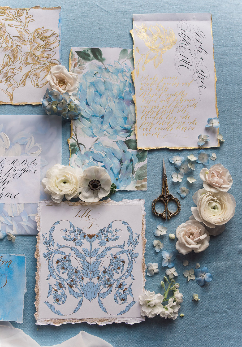 French Wedding Stationery with blue watercolour design and displaying a table number