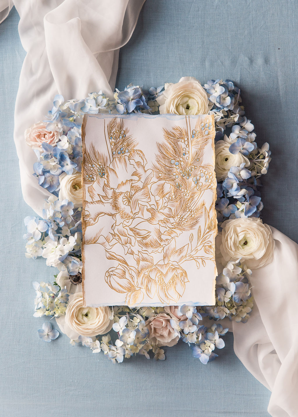 Gold calligraphy floral illustration statement piece with hints of pale blue for an intimate event in the south of France.