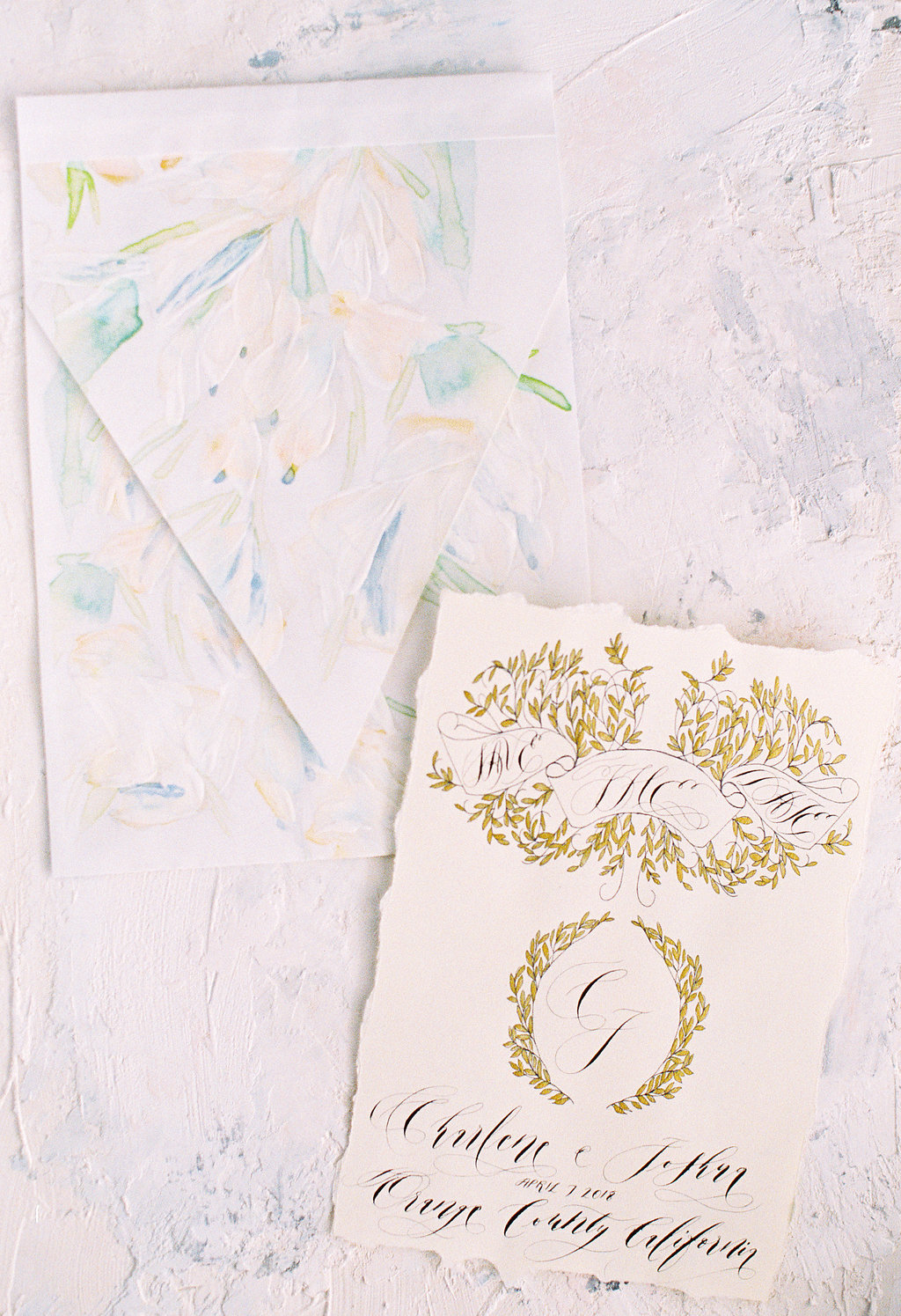 Handmade large bespoke envelope with pale green and calm blue floral watercolour designs and hand painted acrylic paint brushstrokes