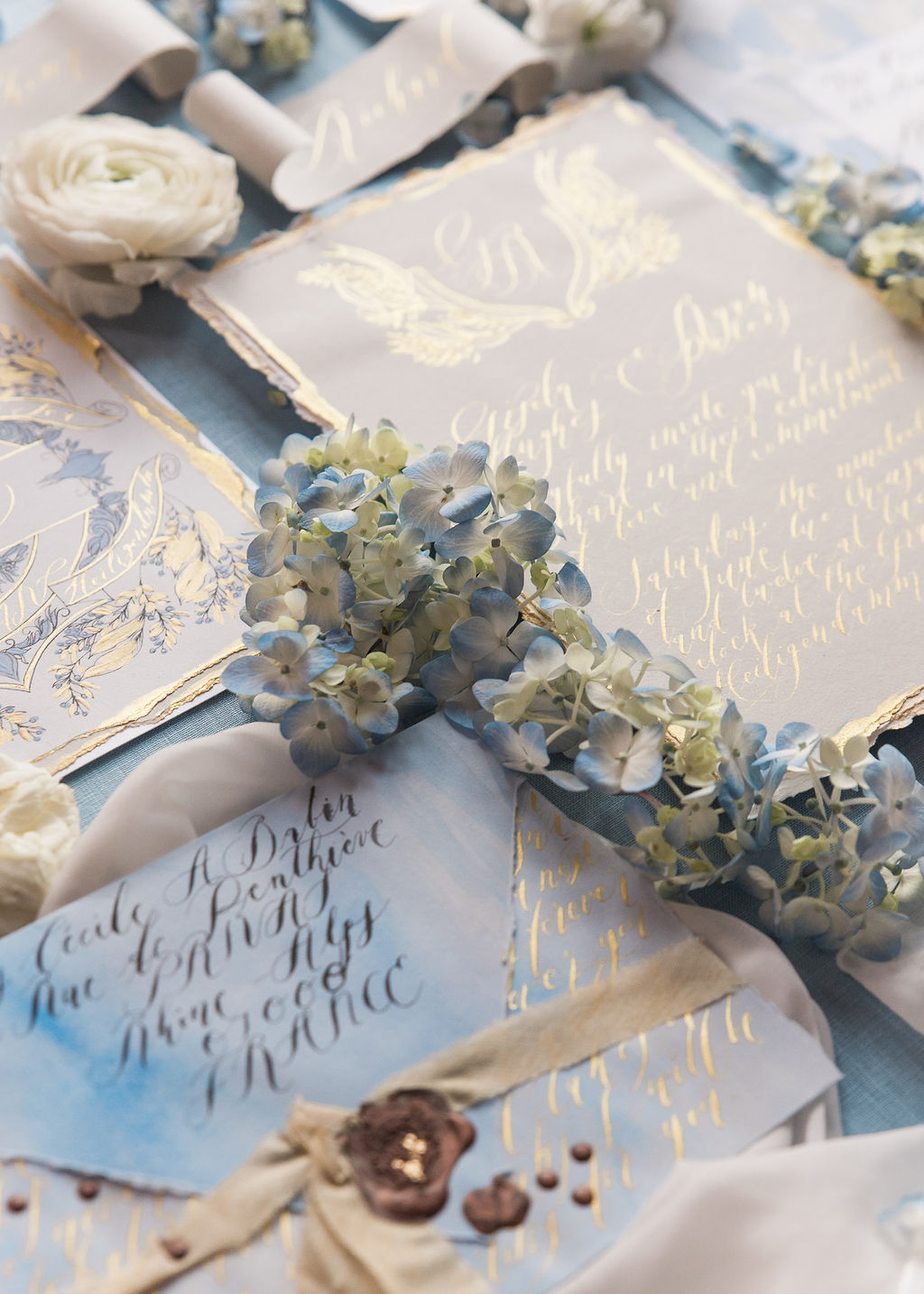 Luxury wedding stationery with a French design inspiration, with gentle blues, champagne, white and hints of antique gold for a high end destination wedding in Paris, France