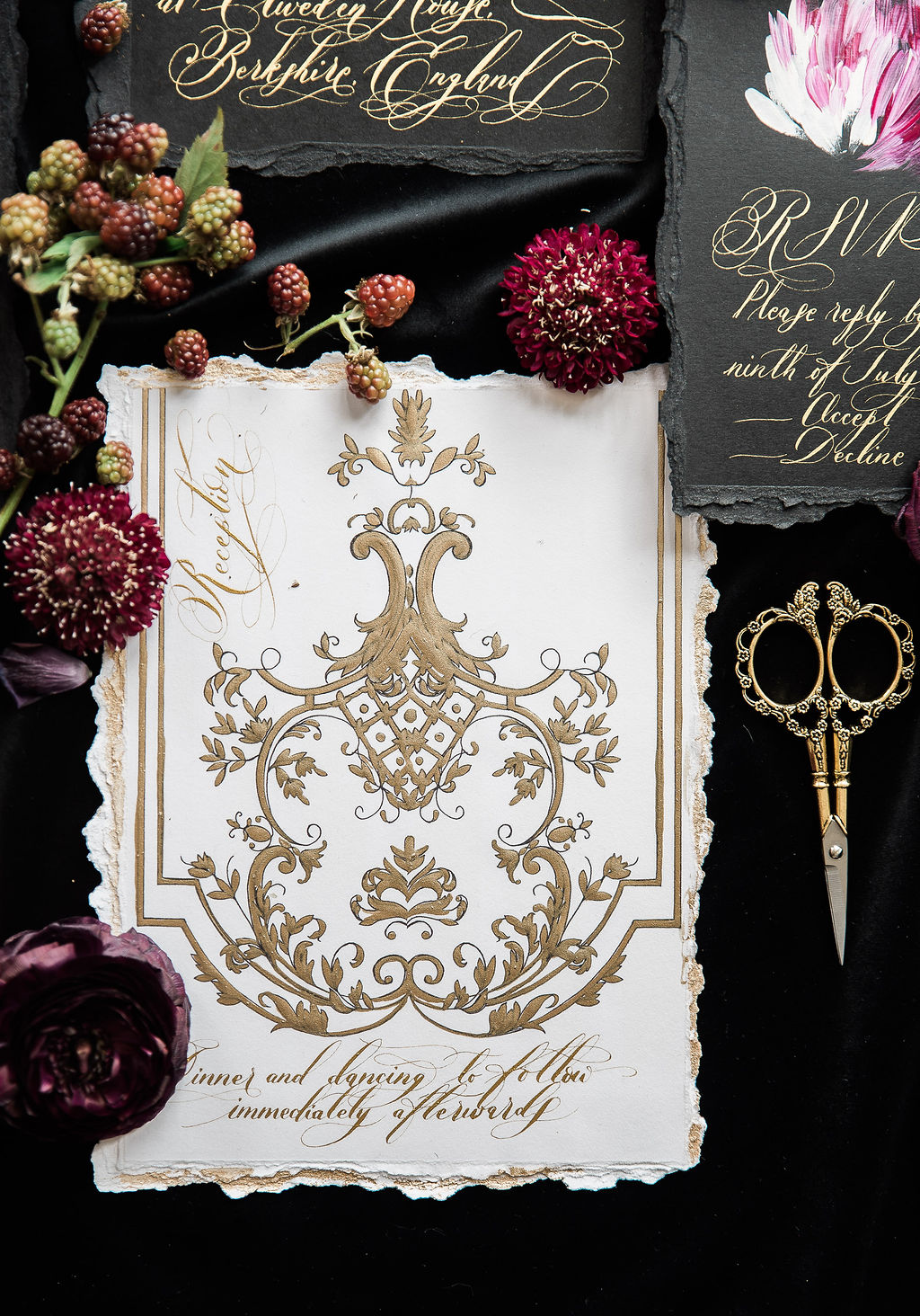 Luxury wedding stationery with gold ornate filigree designs with gold calligraphy and torn edges
