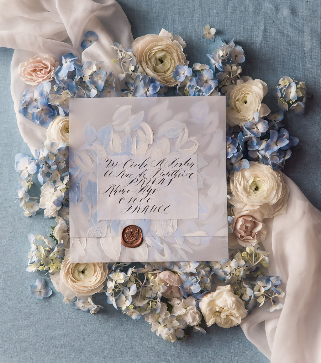Romantic and classical vellum envelope with gentle painted brushstrokes in white acrylic paint.