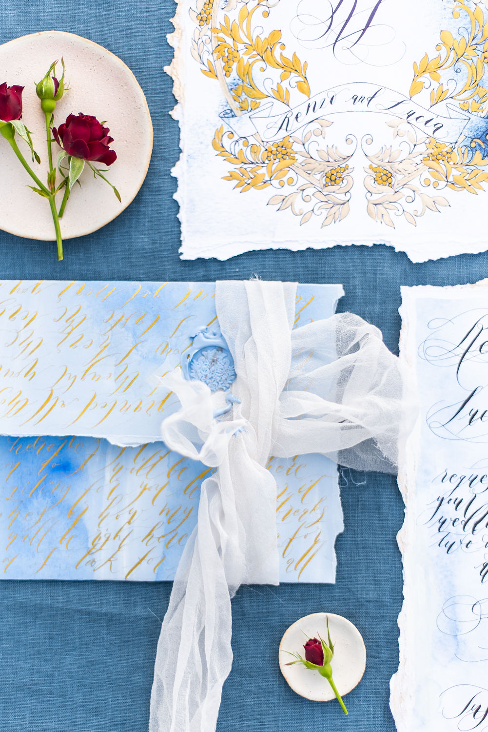 Watercolour white and blue envelope with fine art gold calligraphy for a romantic look.