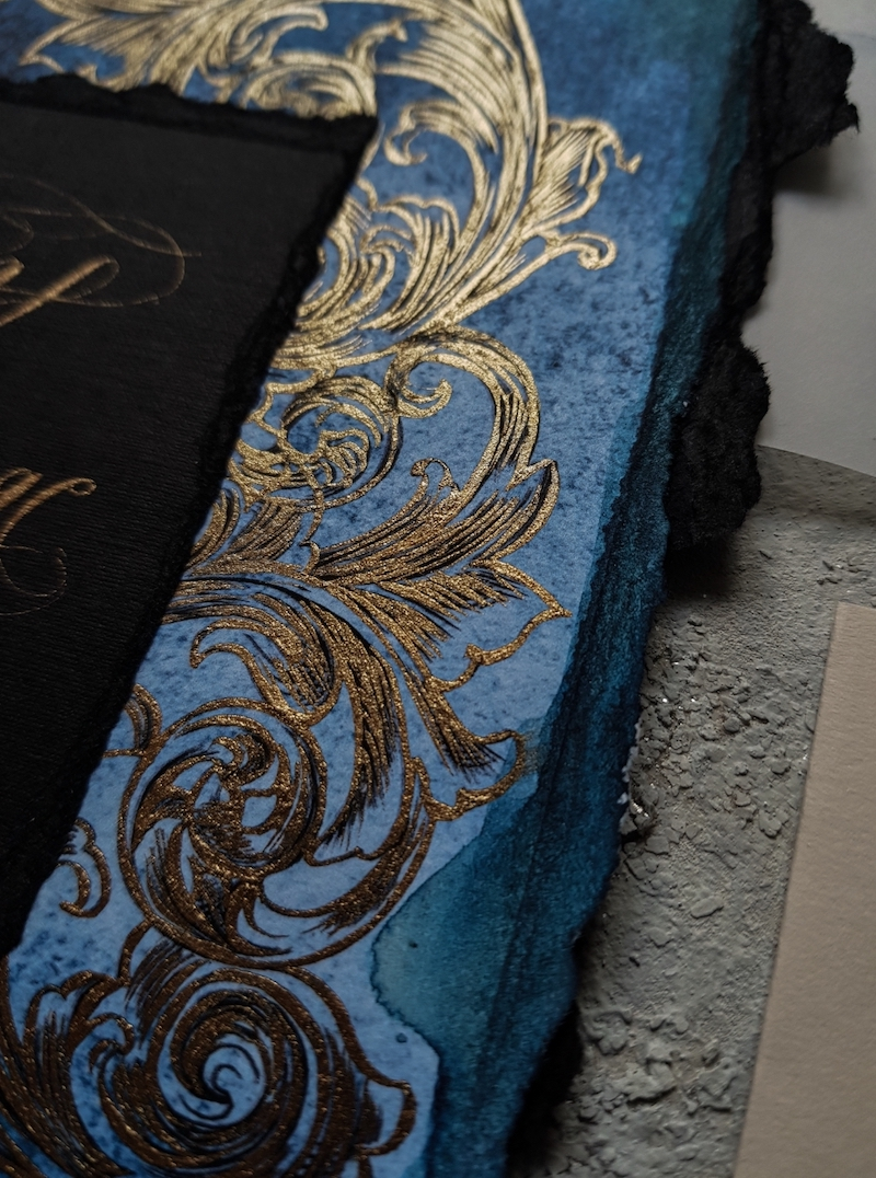Dark navy blue watercolour wedding invitations with gold detail