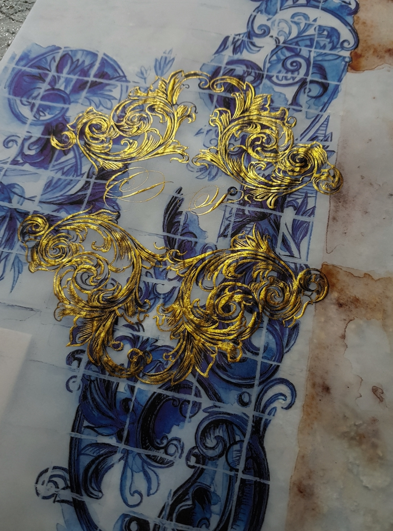 Deep blue azulejos watercolours with gold crest design and monogram