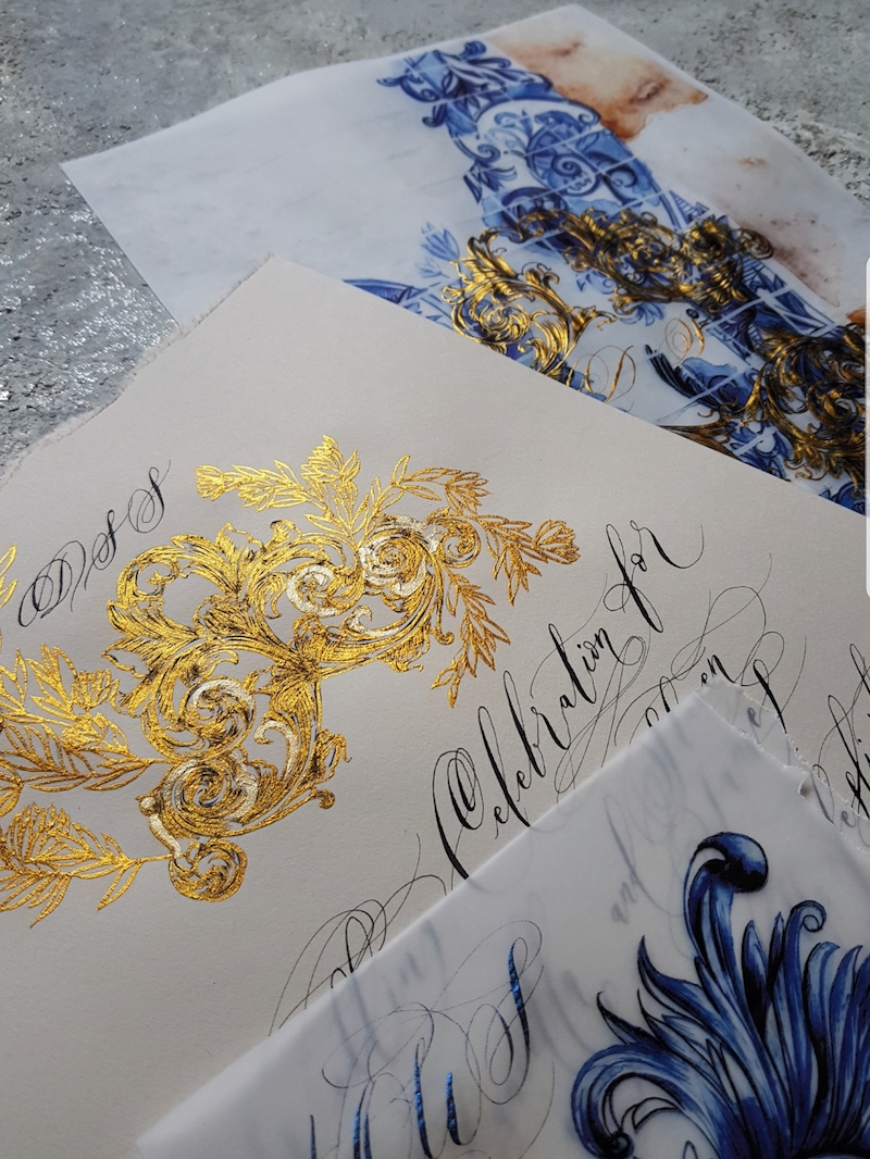 Destination wedding invitations with rich blue, cream and gold accents