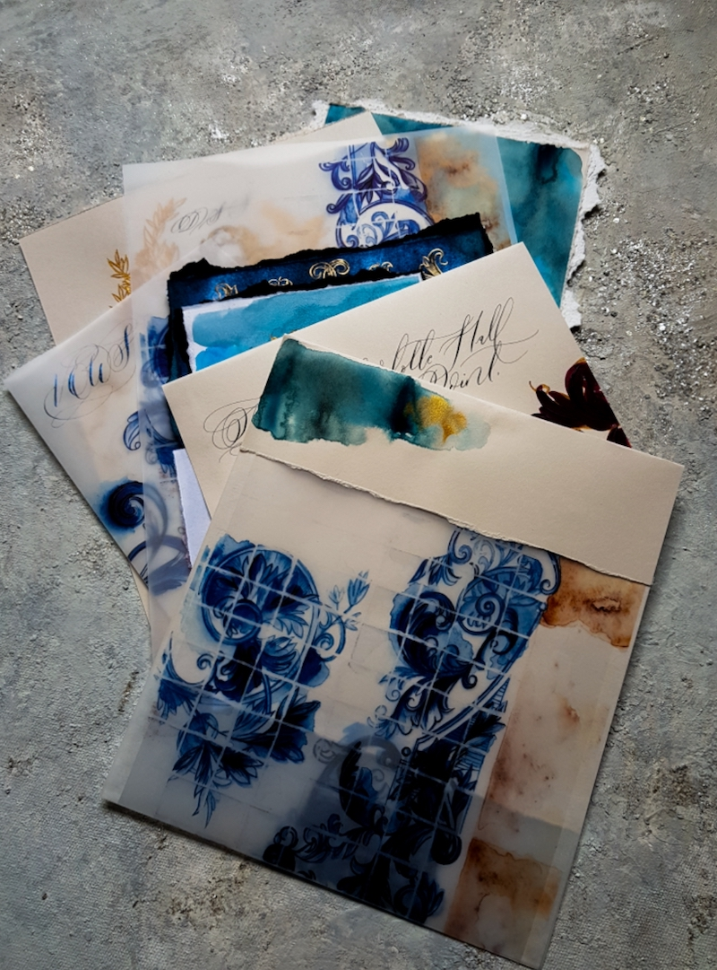 Hand painted wedding stationery suite with illustrated navy blue, teal and gold watercolour designs for a luxury destination wedding in Portugal