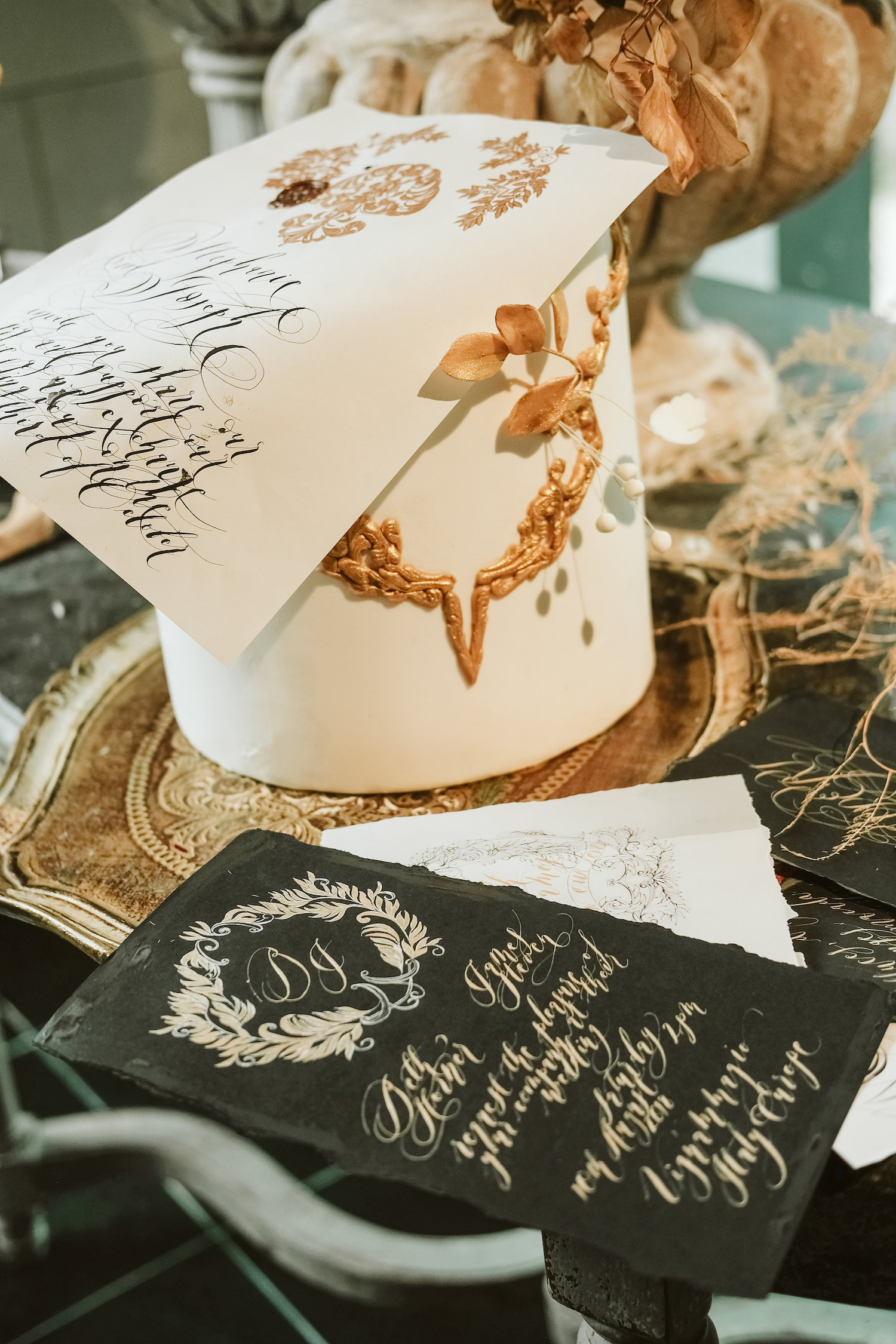 Moody French style invitation with black, gold and hand painted details