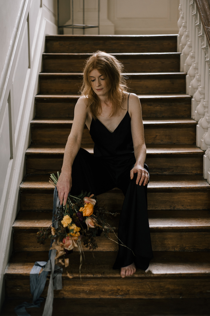 Skipwith Hall house with bride sitting on stairs