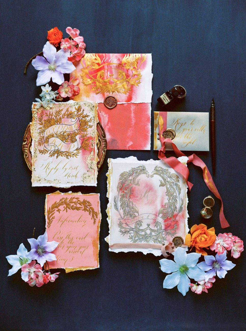 Tropical wedding invitations with accents of deep coral and gold