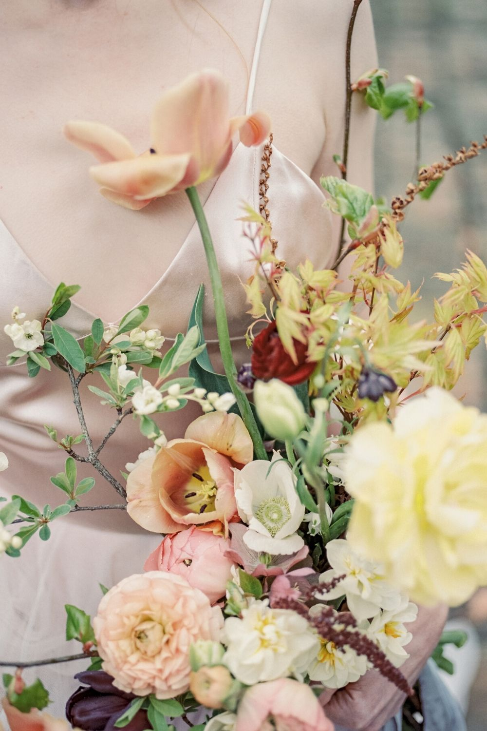 Fine art bridal bouquet with a mixture of natural flowers and leaves