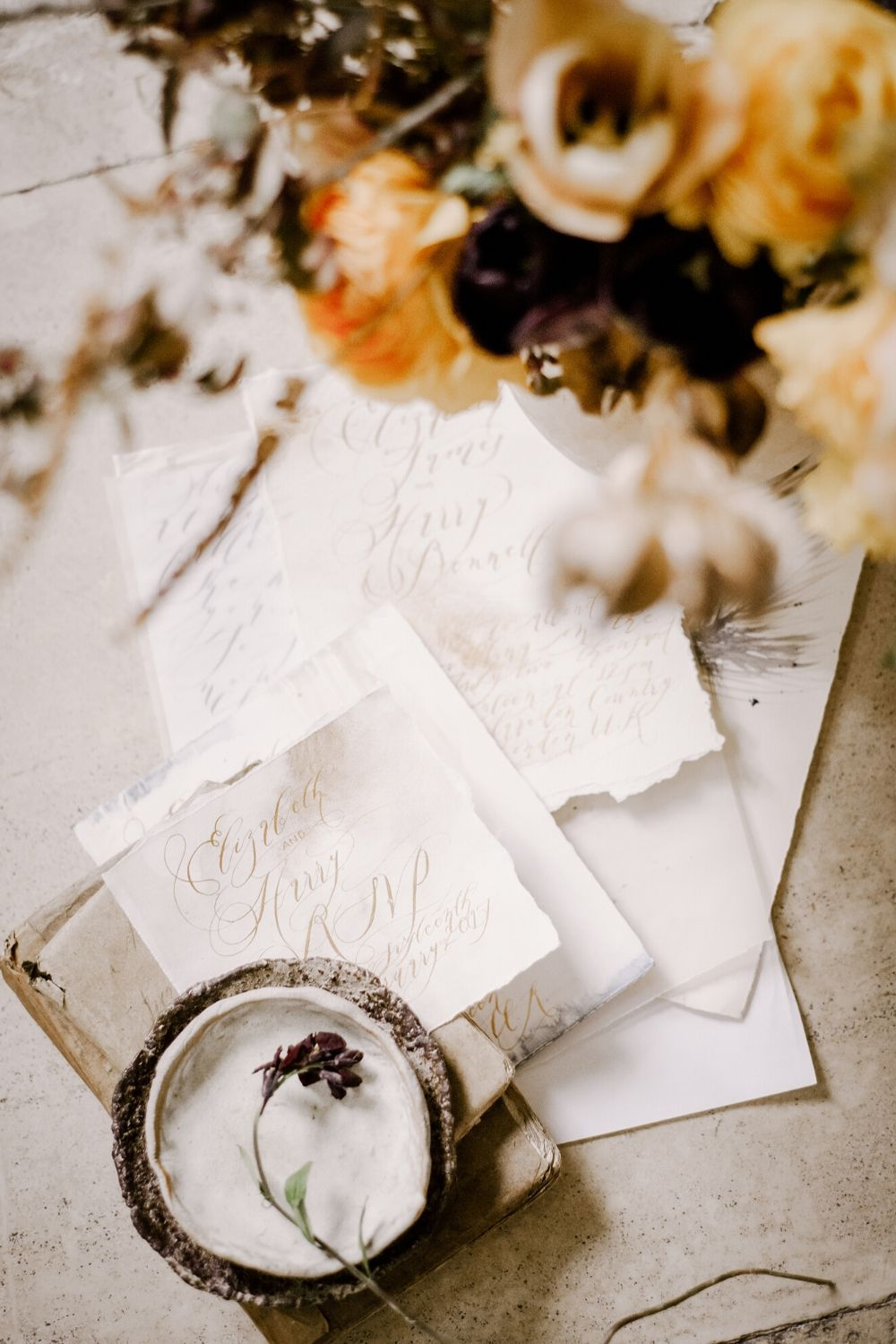 White fine art wedding stationery with gold watercolour and calligraphy