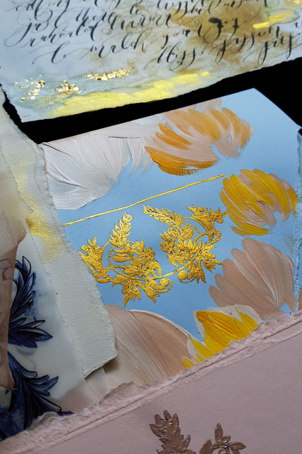 Hand painted blue envelope with blush and deep ochre yellow flowers with a vintage crest for fine art wedding at Lake Como