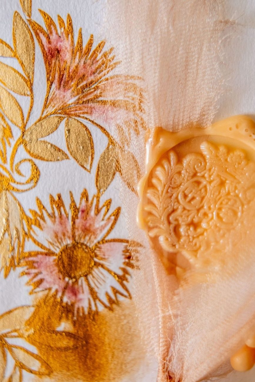 Gold, calligraphy floral artwork for luxury wedding stationery close up detail