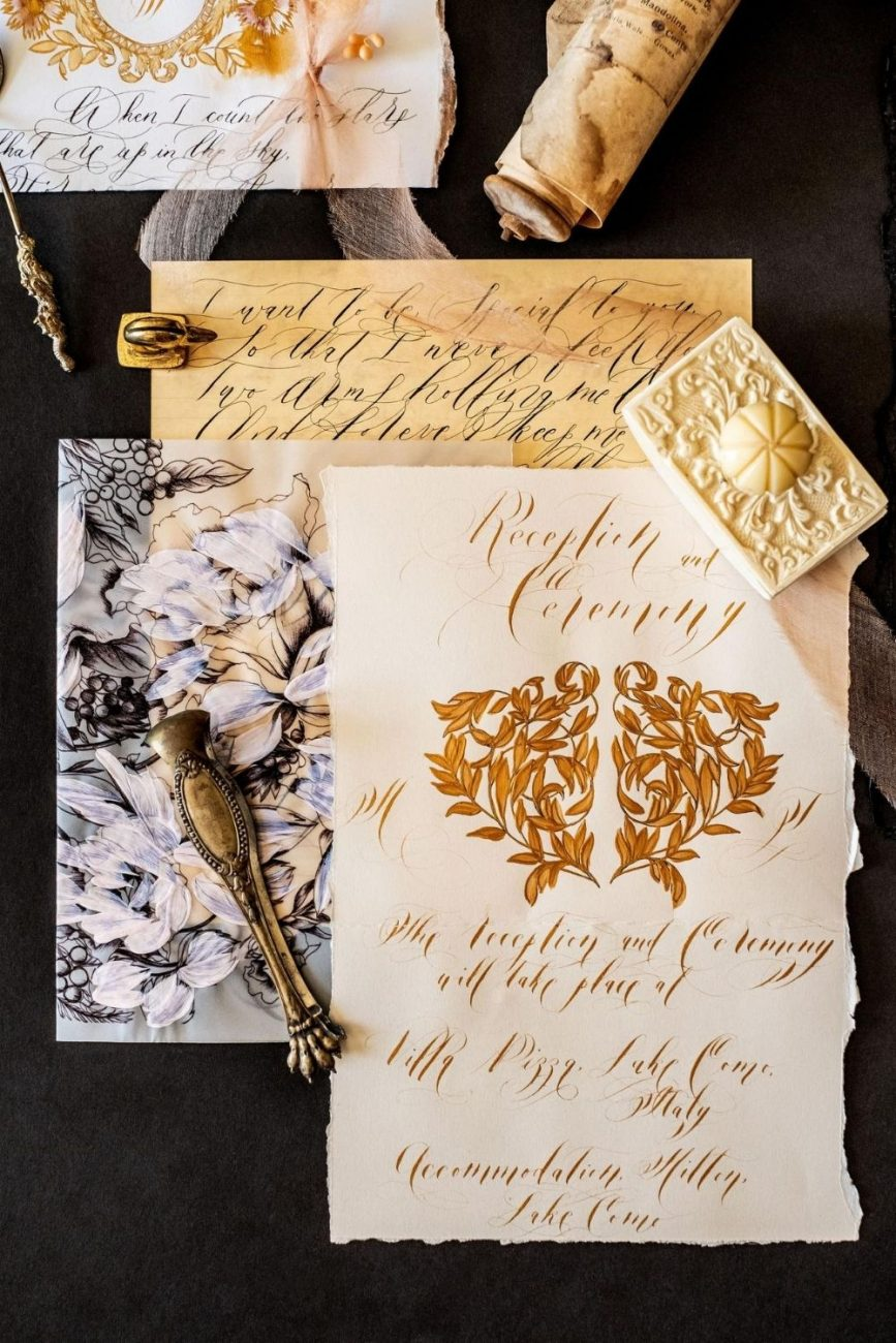 High- end wedding invitations for a luxury wedding in Venice with creme, pale pink and rich black and gold accents.
