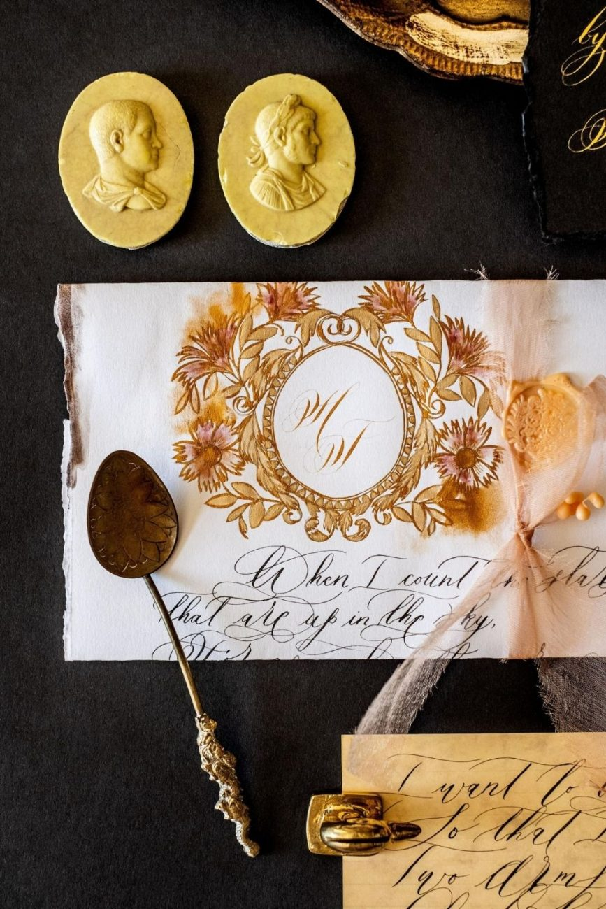 Old World love letter style invitation with a gold crest and watercolour flowers