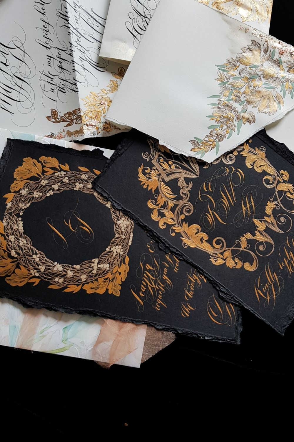 Black tie wedding stationery with black and gold hues and cream, pale grey and green floral design