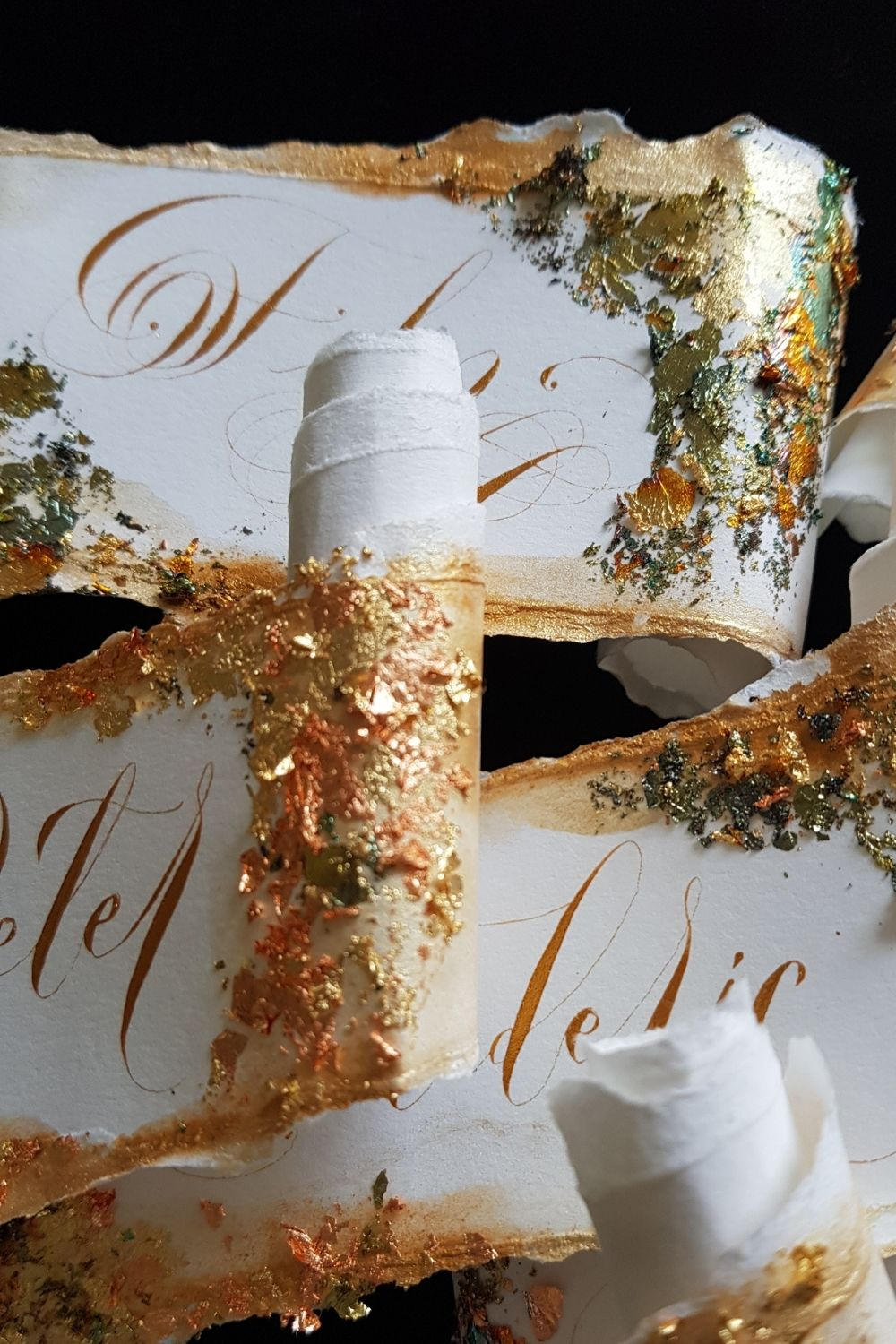 Gold foil leaf details for scroll design place name cards for fine art, luxury weddings and events