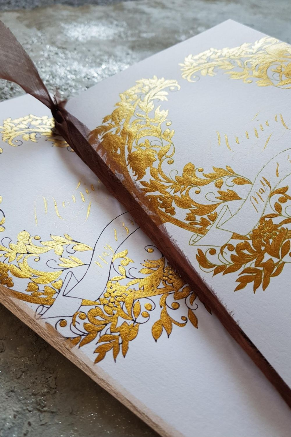 Shangri-La Paris Wedding menus with gold hand painted crest design