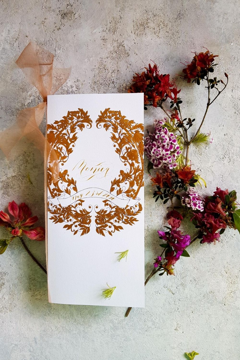 Deep rich coppery gold crest design for wedding menu design for an intimate wedding in Paris