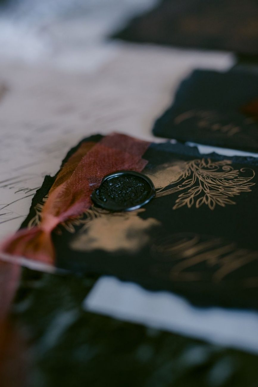 Dark and moody, black tie place names cards for a fine art destination wedding in Sorrento, Italy.