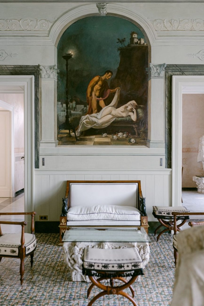 Villa Astor interiors, showing a classical white room with a tiled floor. Perfect for a destination wedding in Italy