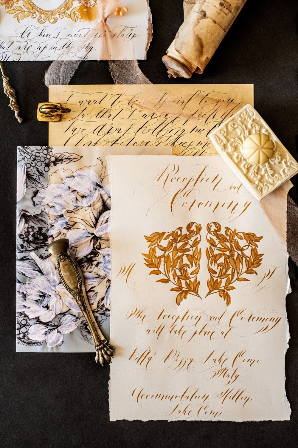 Wedding invitations with handwritten lettering and gold calligraphy for luxury destination weddings in France