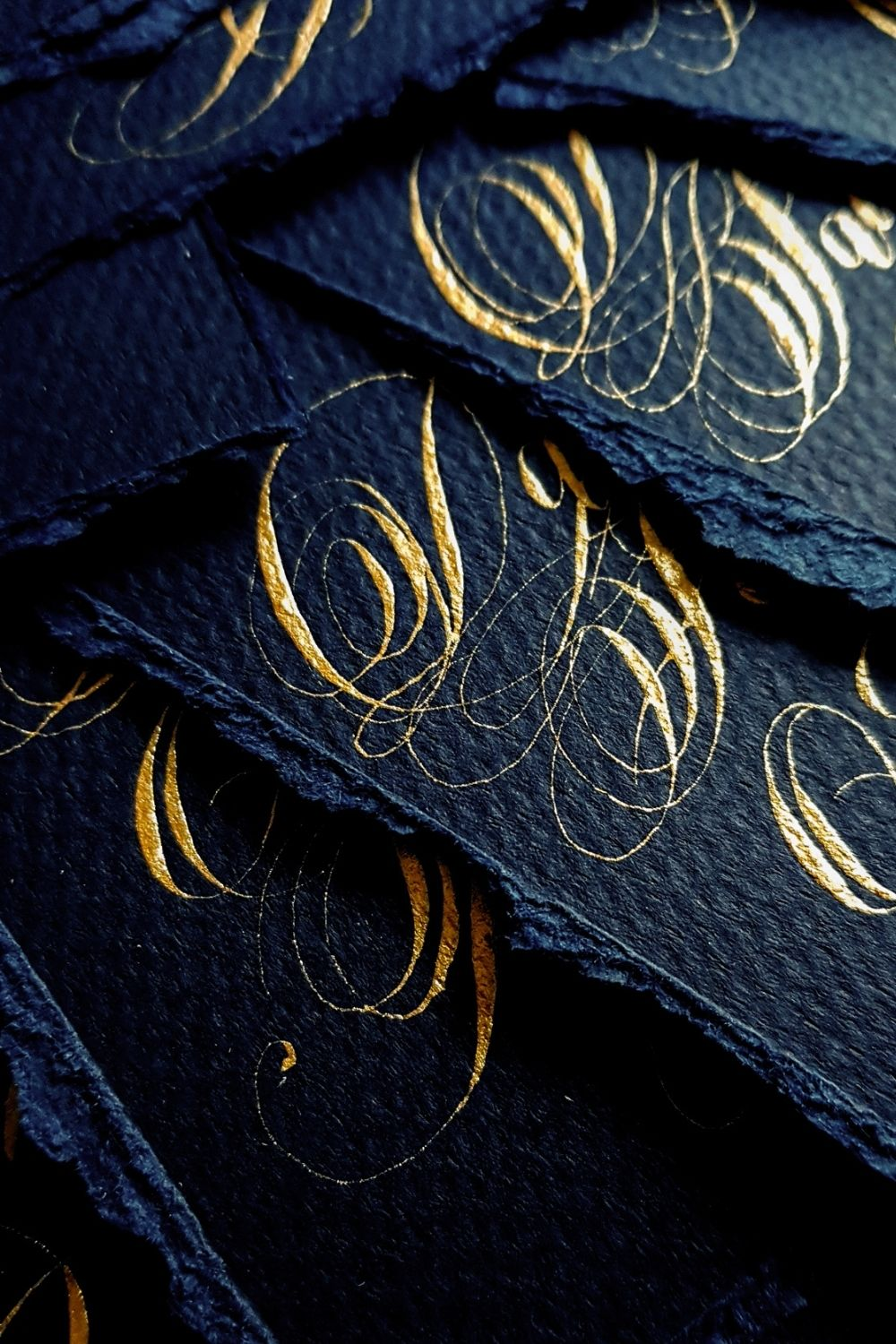 Gold spencerian calligraphy for French style navy blue and pale gold wedding stationery