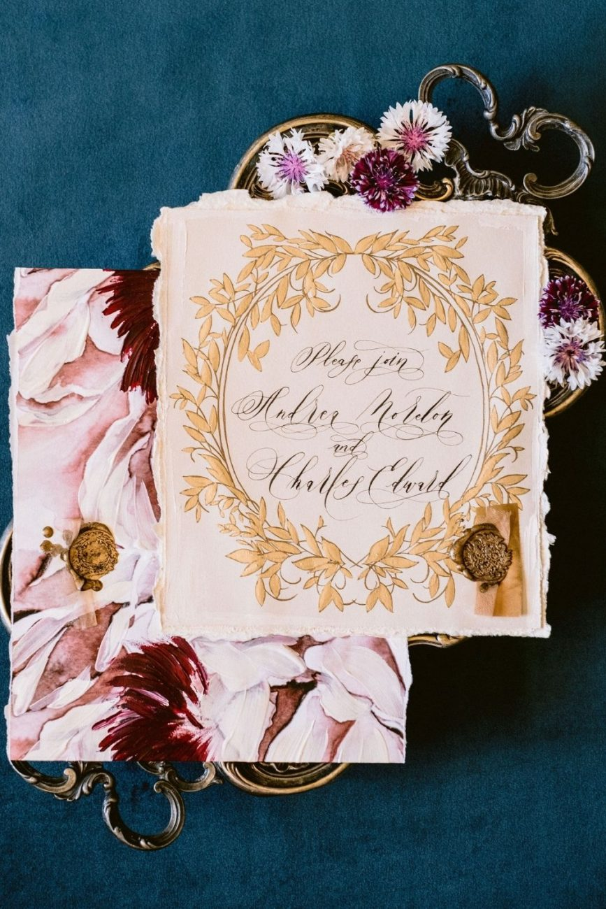 Luxury Italian destination wedding, featuring hand painted and hand made wedding invitation with hand torn edges and gold wax seal