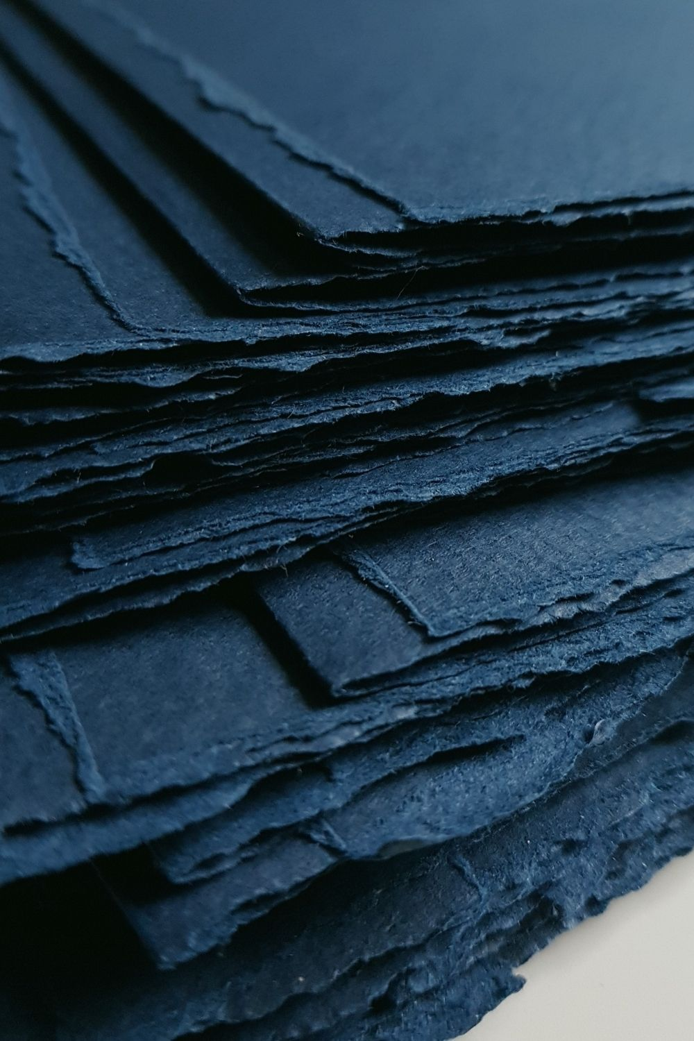 Luxury large hand made envelopes with torn edges for a navy blue and gold wedding invitations suite