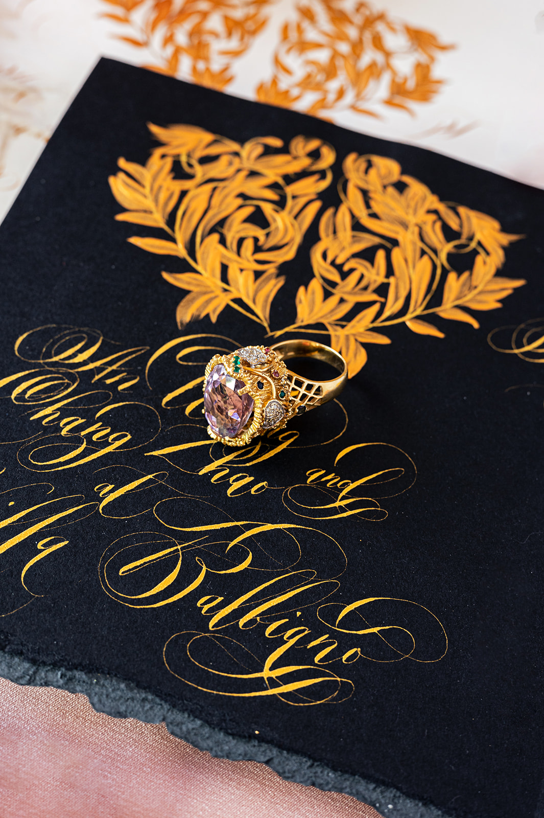 Luxury black and gold Villa Balbiano wedding stationery featuring a hand painted crest design