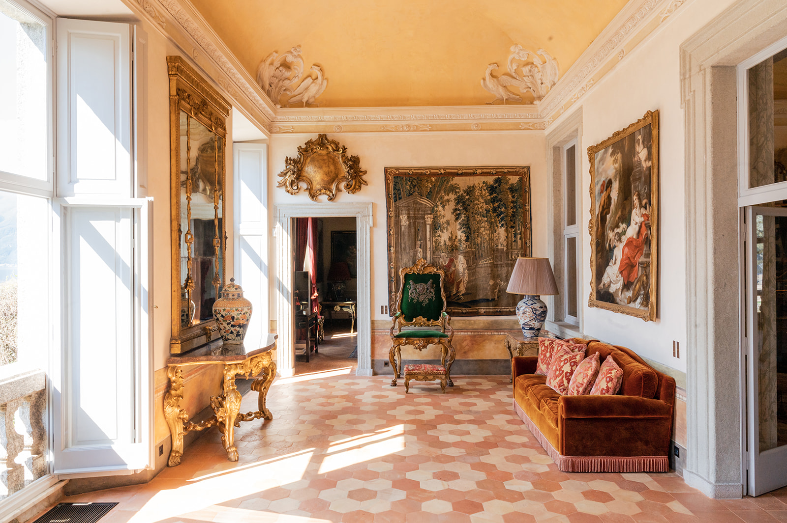 Villa Balbiano's luxurious interiors with gold antique frames and classical furniture