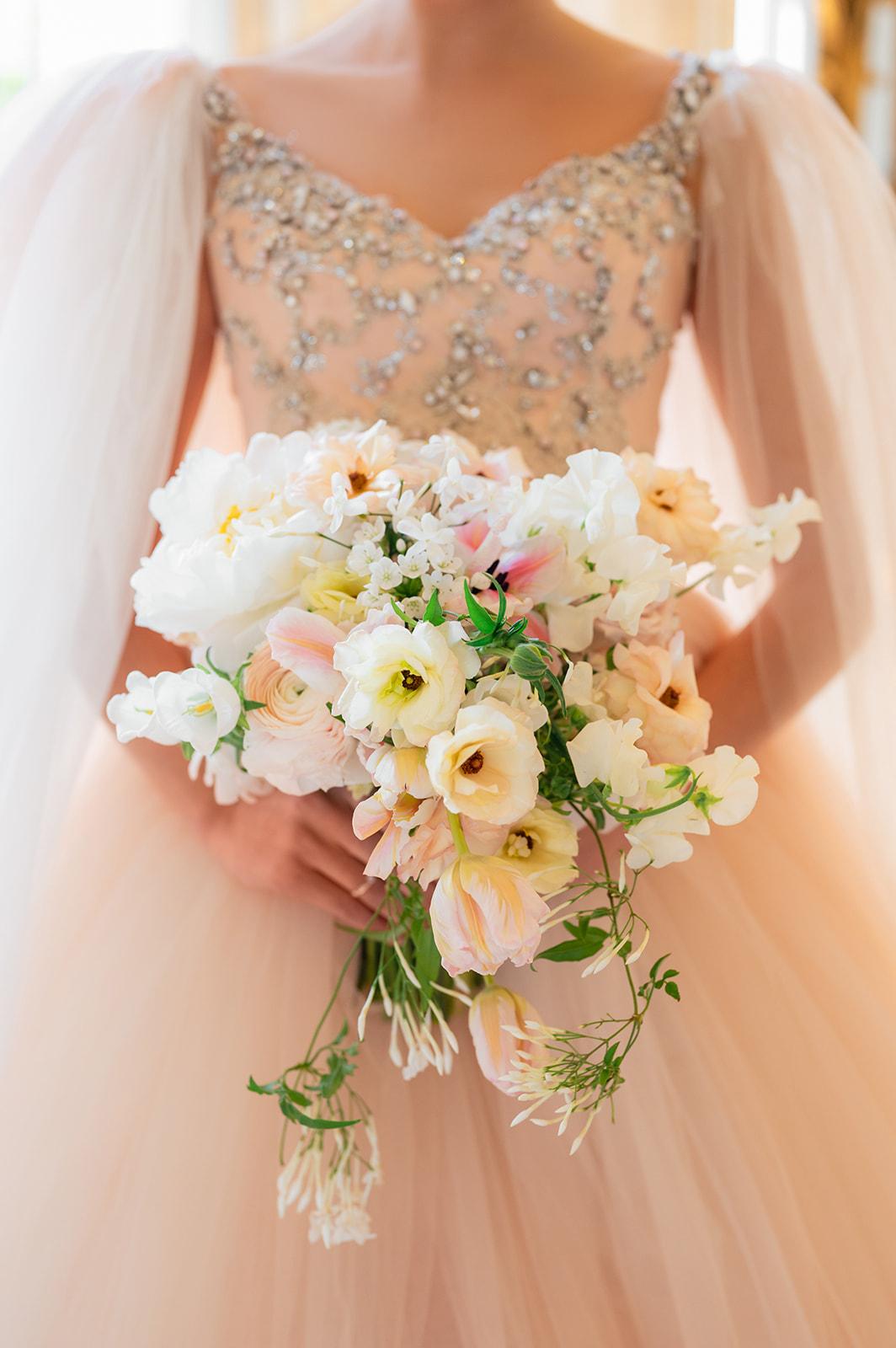 Villa Balbiano luxury destination wedding, featuring a bride holding blush and neutral fine art bouquet