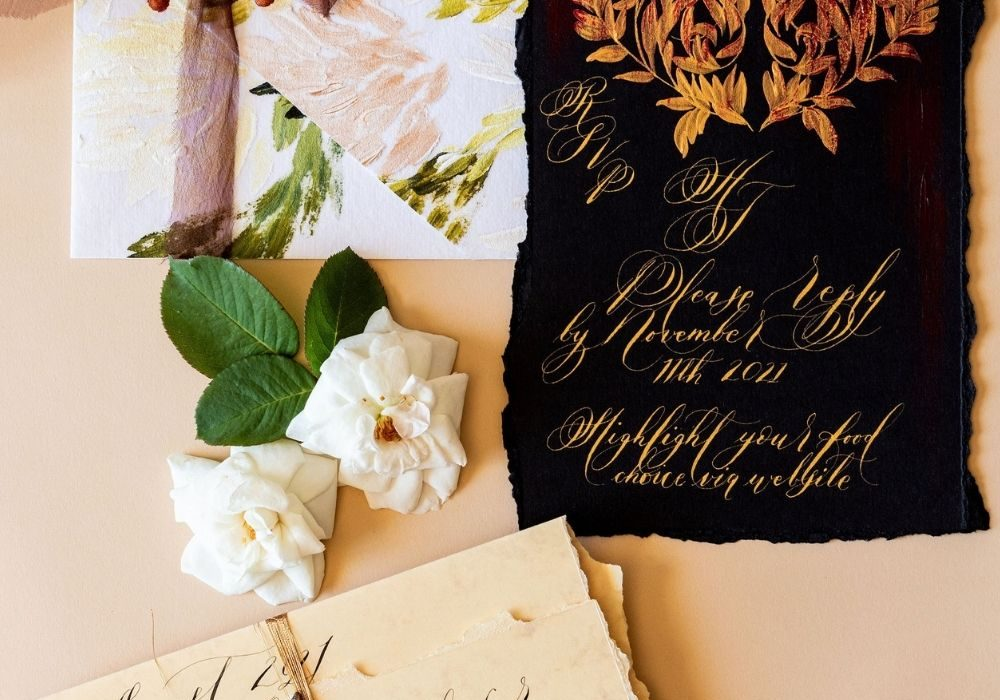Villa Balbiano wedding invitations with moody black, deep copper and floral details
