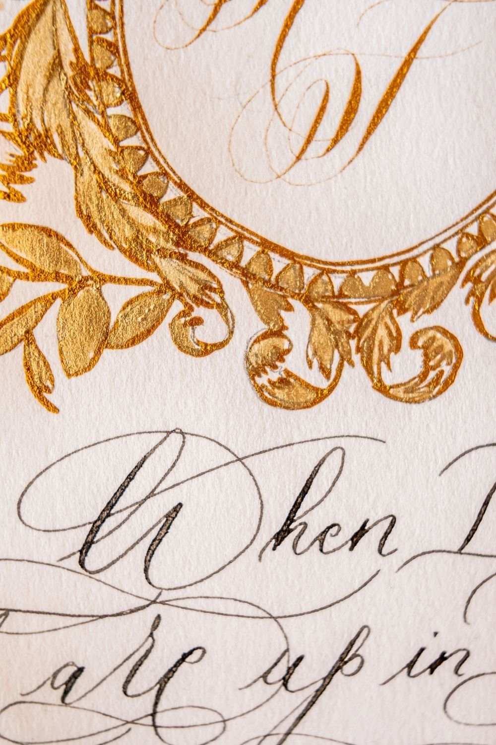 White and gold hand painted crest design for a timeless and elegant Italian inspired destination wedding