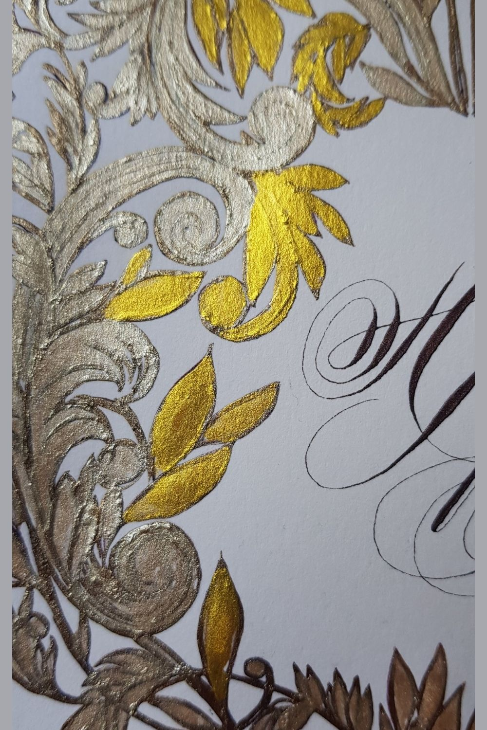 Hand painted, luxury custom crest design with pale brown gold and deep rich gold for an Italian destination wedding