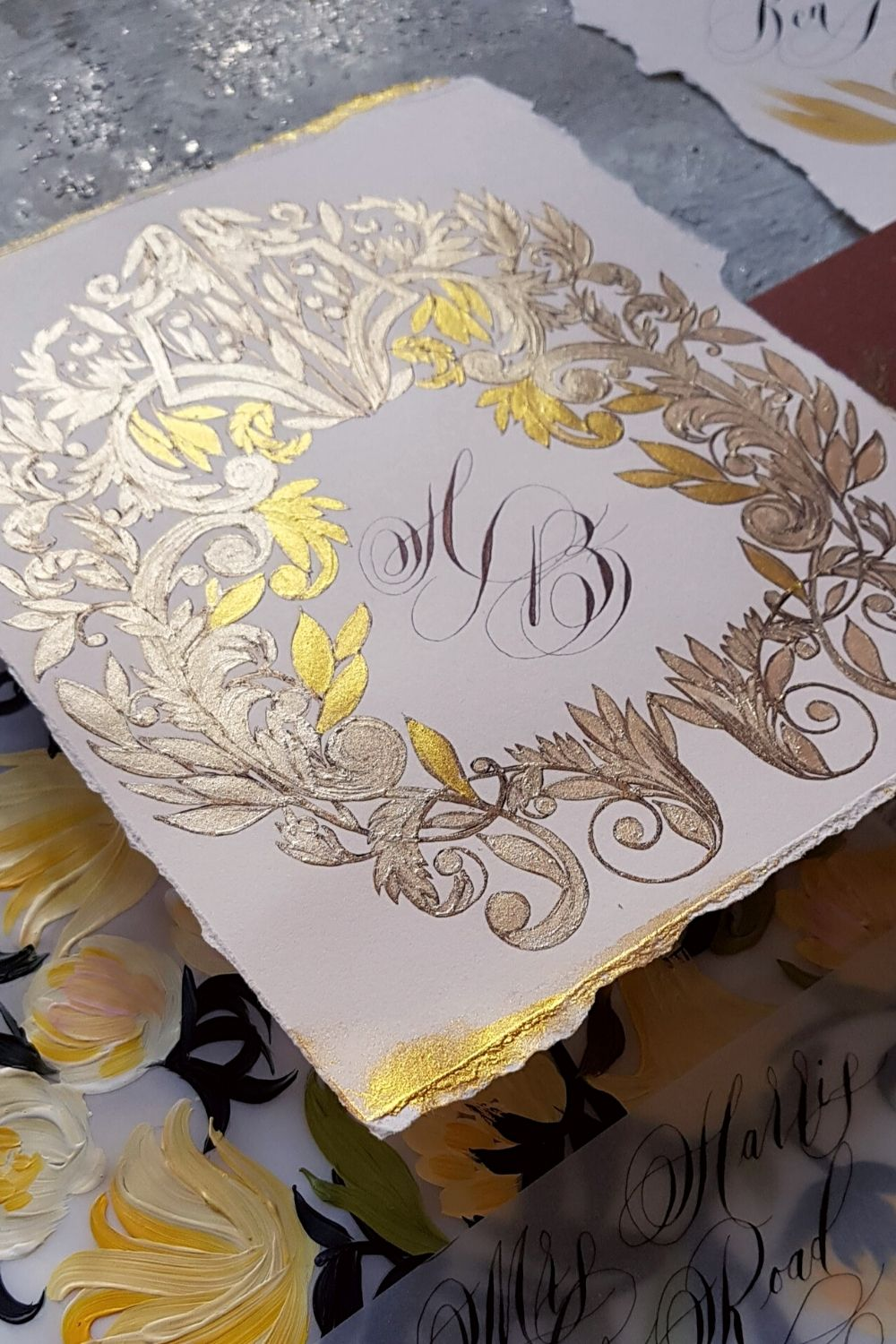 Luxury wedding invitations with rich gold and walnut brown, ornate custom crest design and a floral envelope for an Italian wedding
