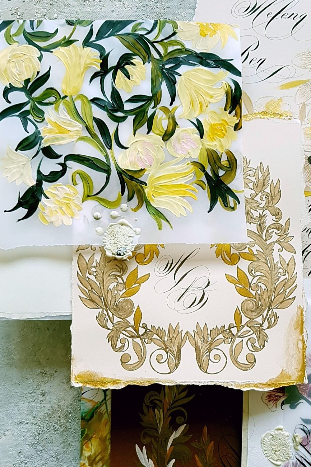 Yellow and green floral wedding invies with a hand painted statement envelope and a crest design monogram card