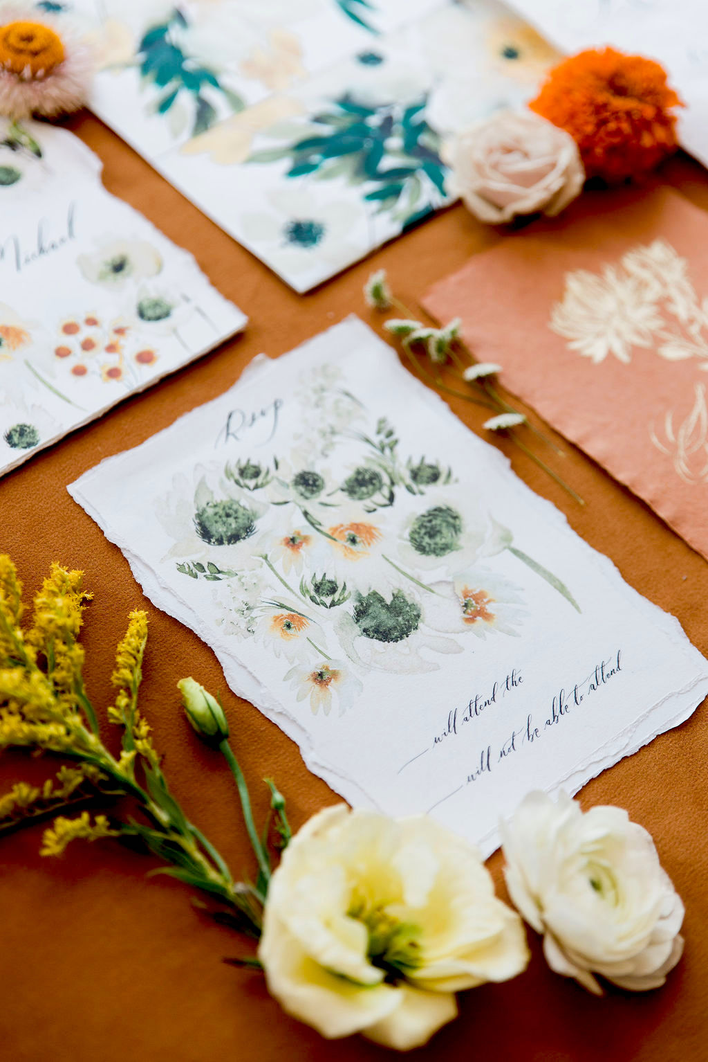 Rsvp card with delicate floral watercolour designs and hand torn edges