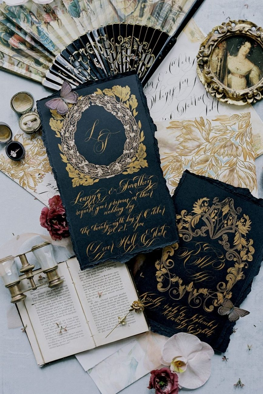 Capri wedding invitations with black and gold baroque design