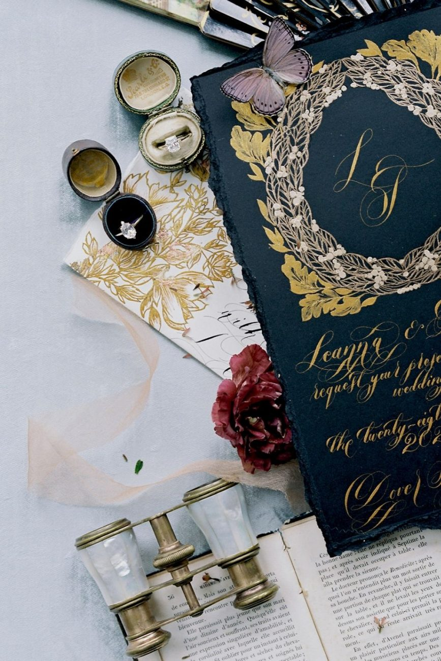 Capri wedding invitations with black and gold baroque design with a large crest design