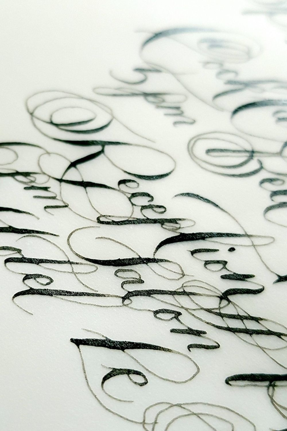 Classical hand applied calligraphy onto vellum for an elegant French wedding stationery suite