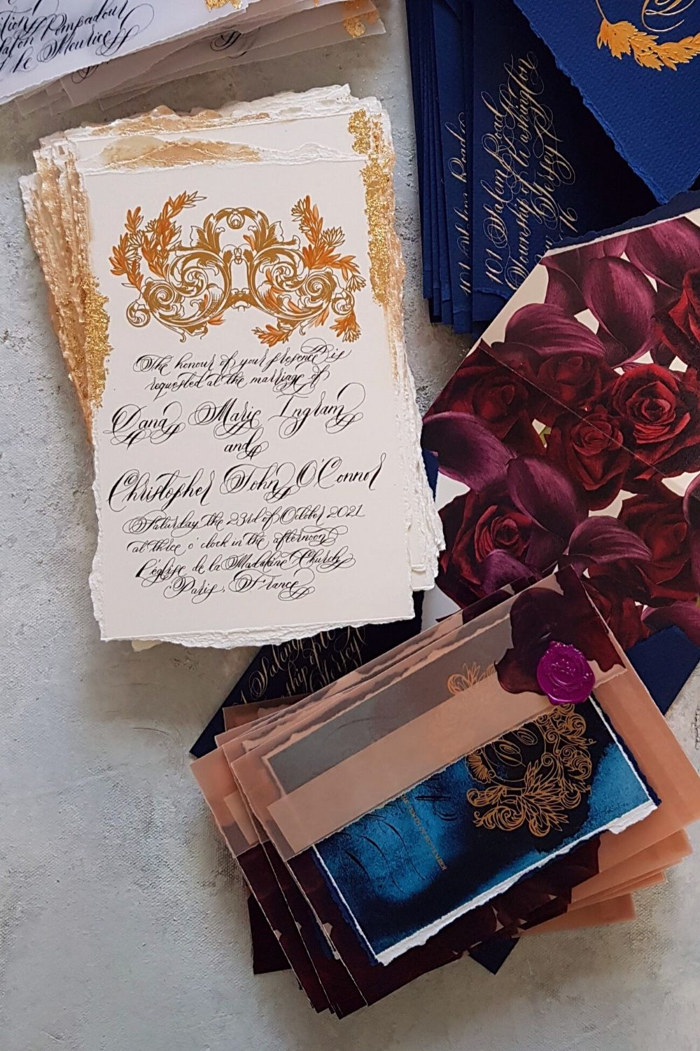 Dark blue watercolour rsvp card design with vellum envelopes and white and gold invitations