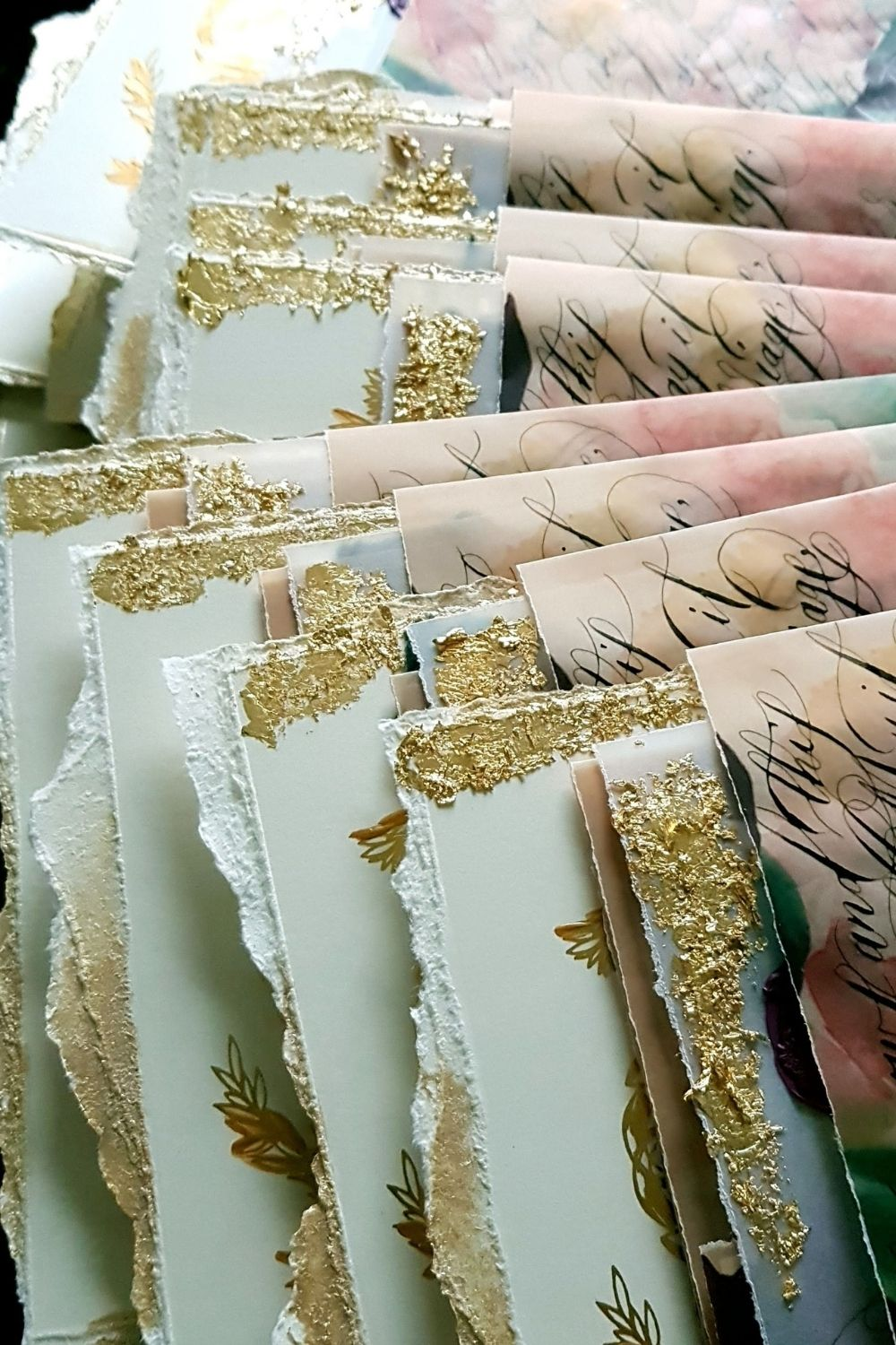 Elegant, fine art wedding stationery with refined details, hand torn edges and gold foil touches with black calligraphy vellum wraps
