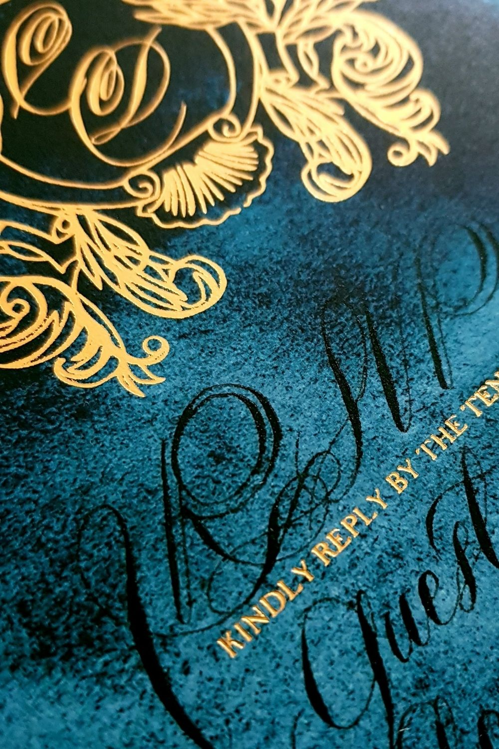 RSVP card design with a deep blue watercolour background, close up detail