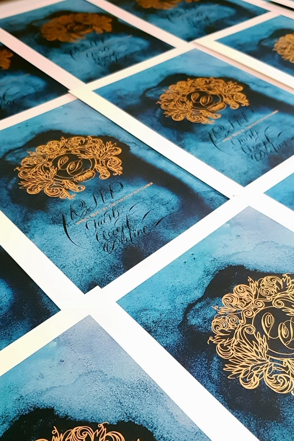 RSVP card design with a deep blue watercolour background with black hand calligraphy