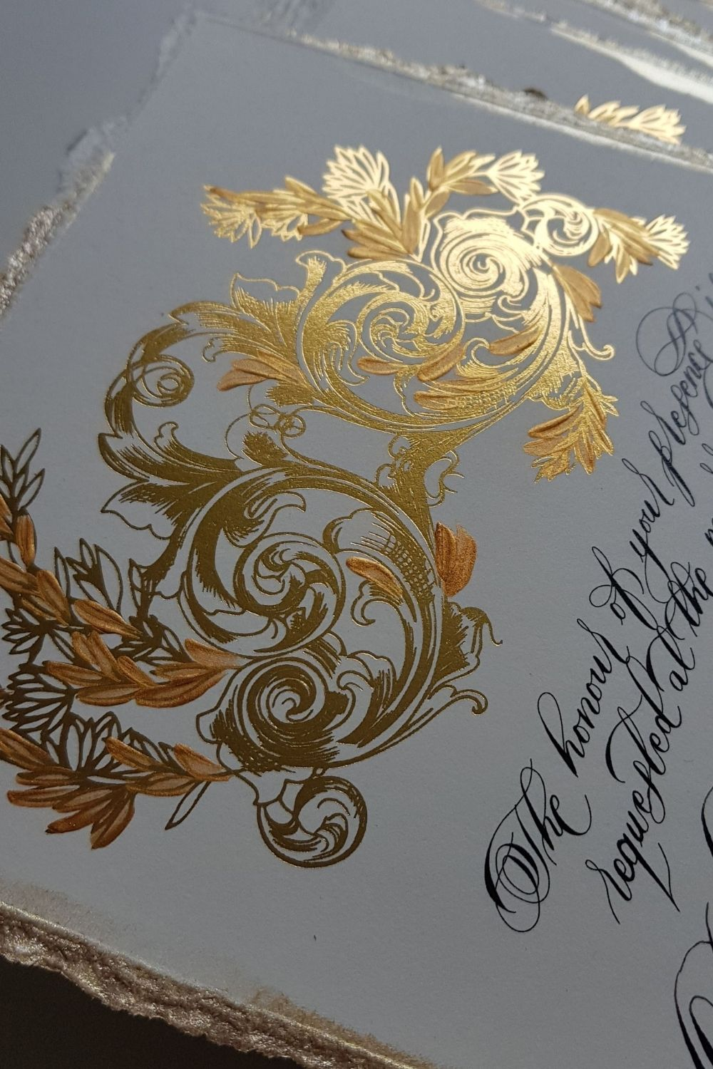 White and gold, gold foil invitations for an ornate and classical French renaissance style inspired, destination wedding stationery